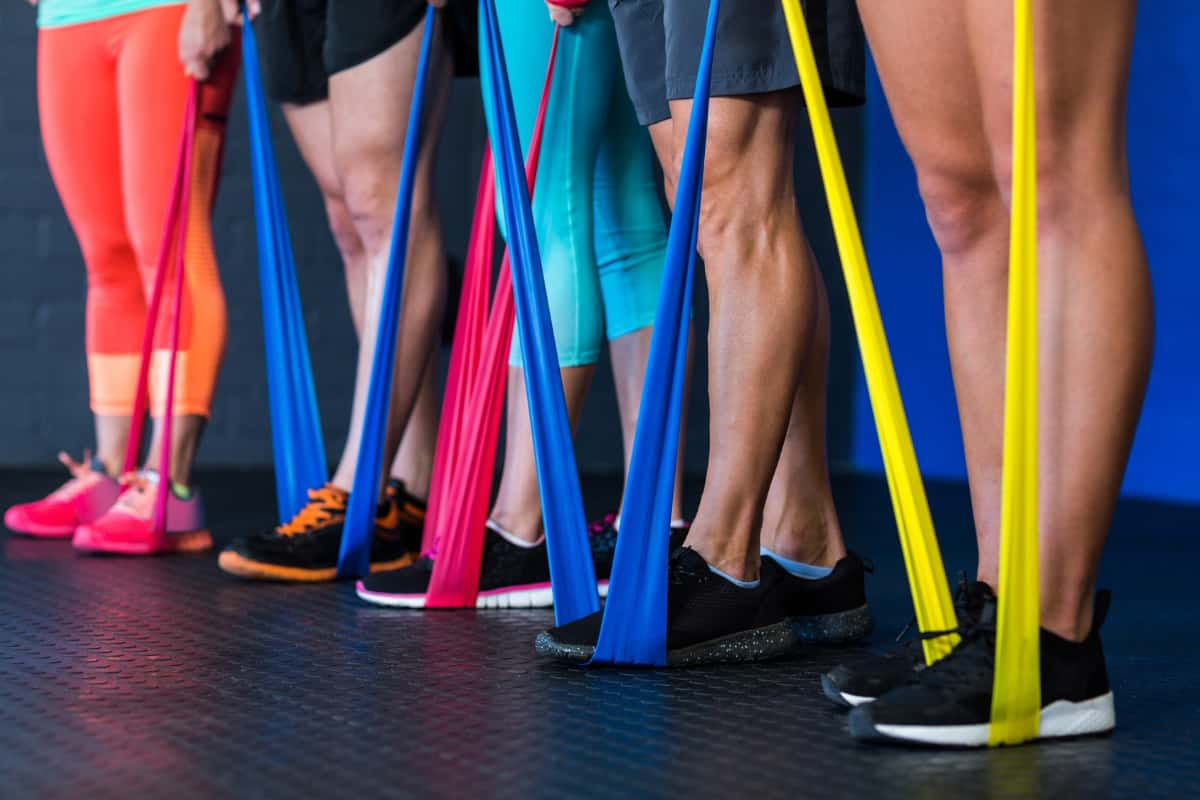 group of people exercising with resistance bands