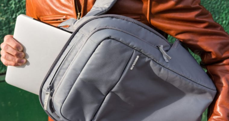 man putting a laptop in a backpack