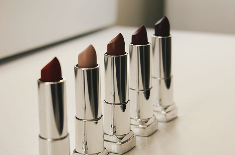5 lipsticks in various shades of red
