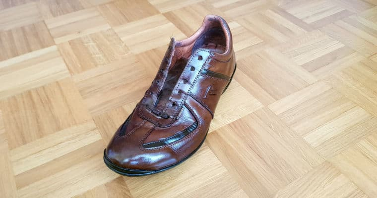 unlaced brown leather shoe