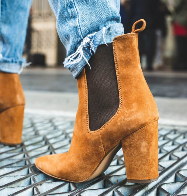 brown suede leather boots on women's feet