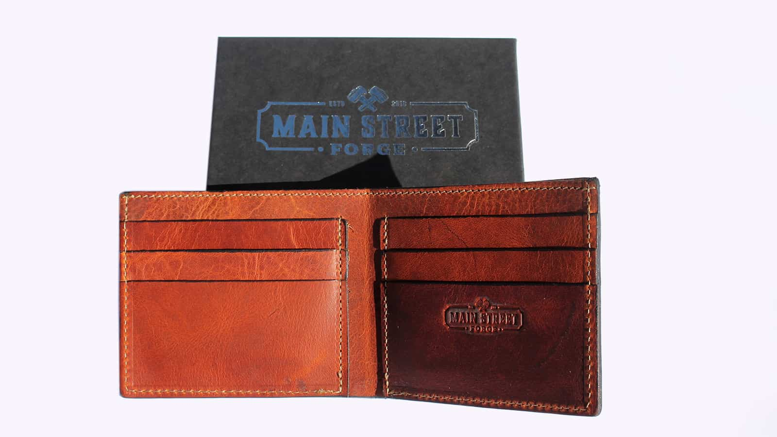 Main Street Forge Leather Bifold Wallet (Tobacco snakebite brown) - Open