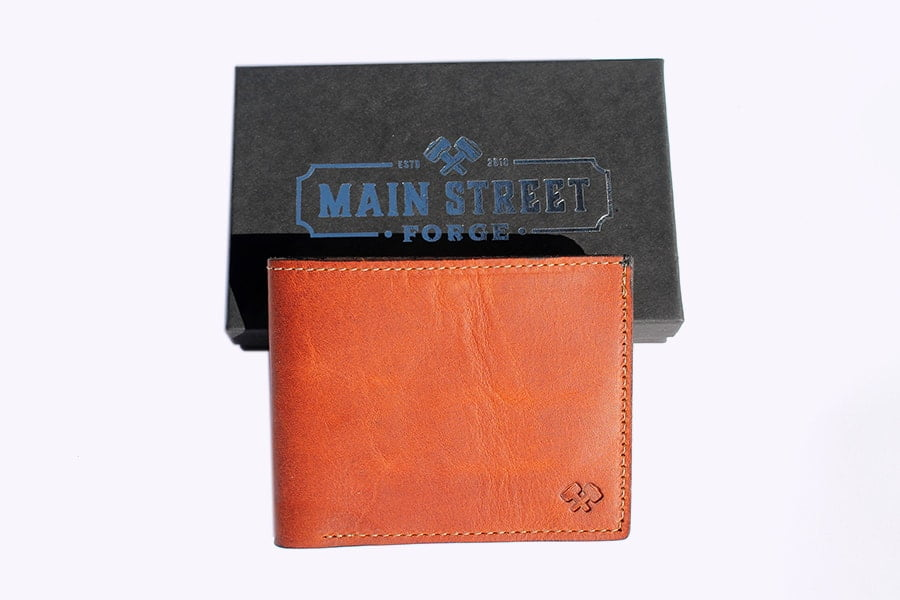 The front of Main Street Forge Leather Bifold Wallet (Tobacco snakebite brown)