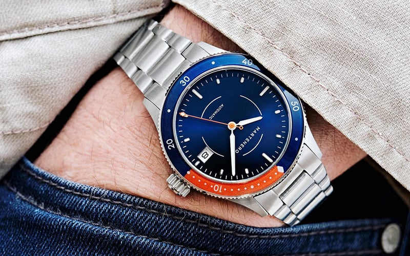 man holding his hand in pocket with a martenero watch on his wrist