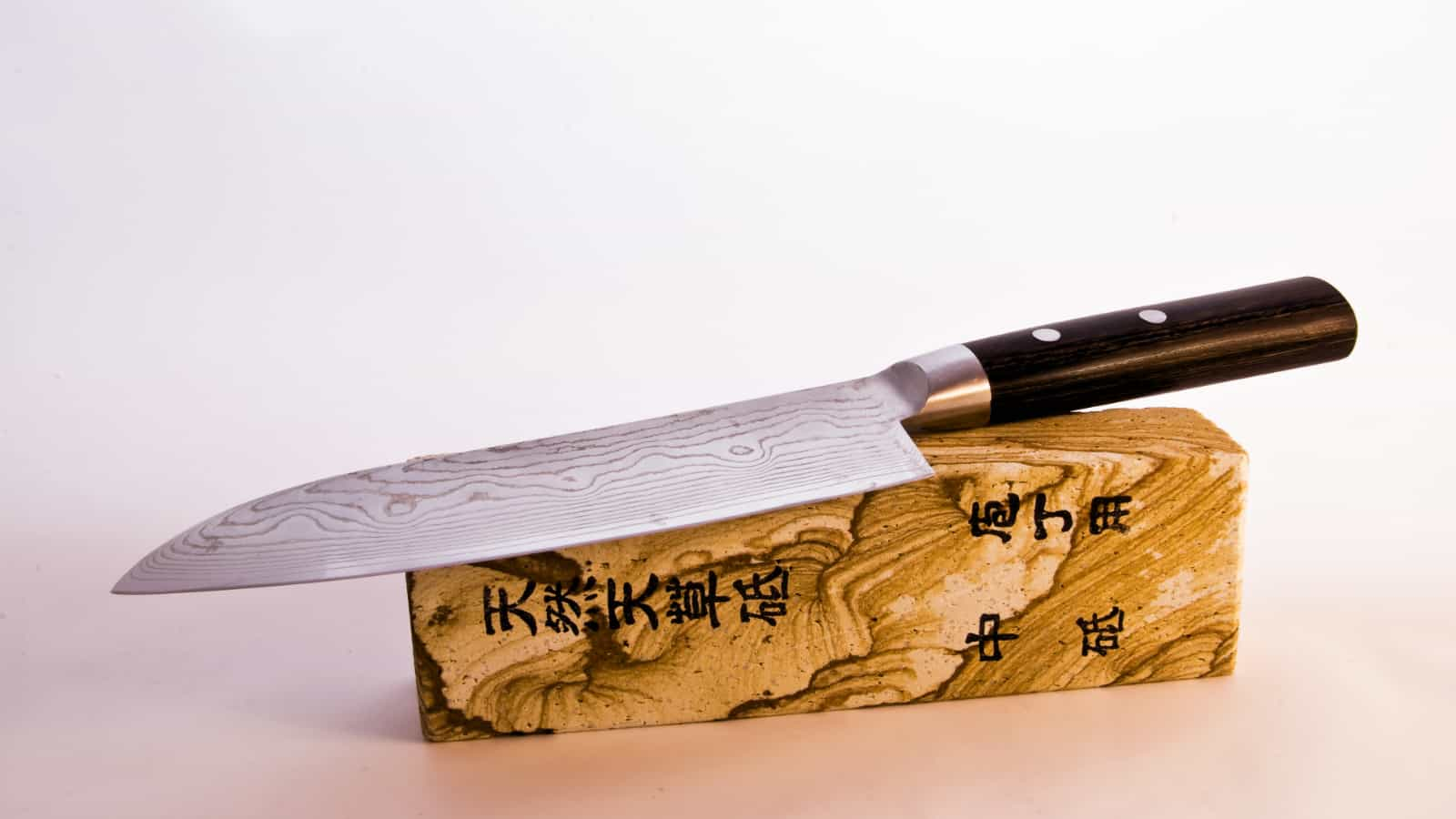 Detail of a Japanese kitchen knife made out of Damascus steel