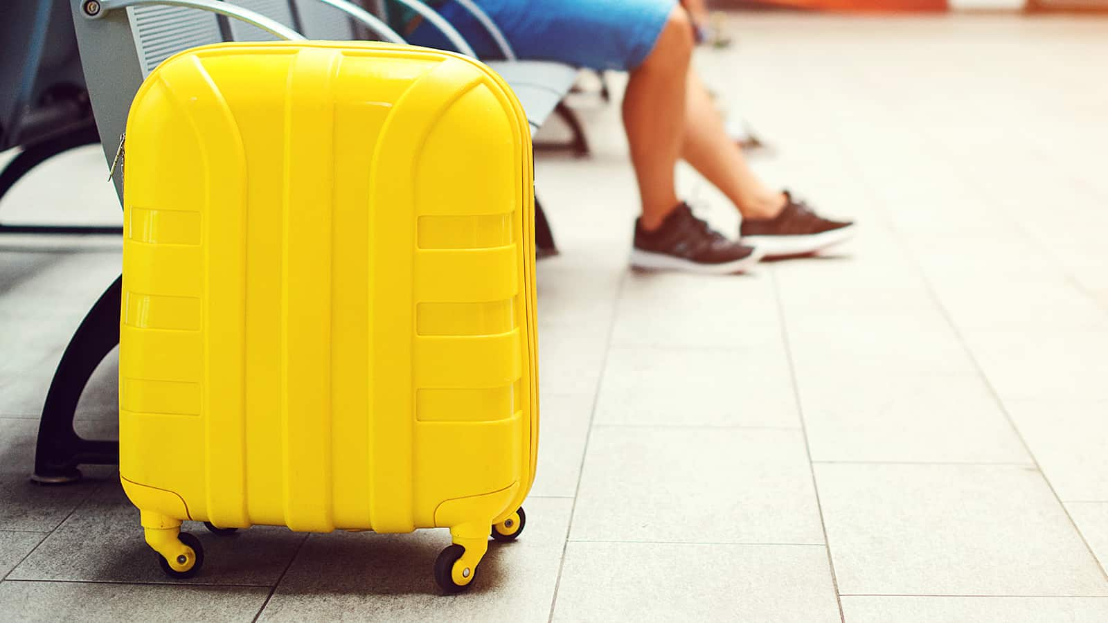 Yellow suitcase in the waiting room.
