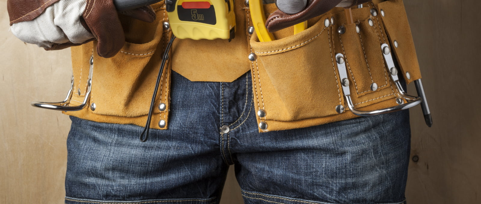 professional in jeans with work tools