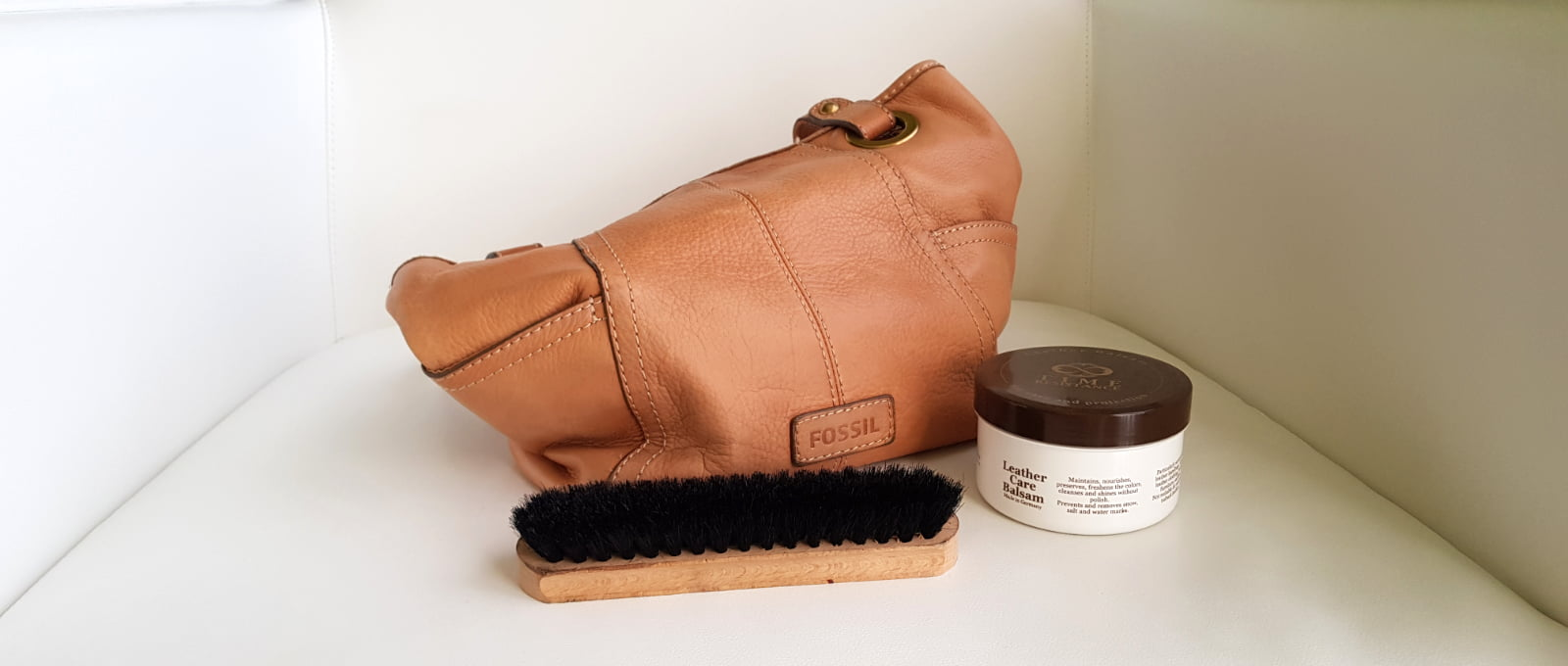 leather handbag with cleaning accessories