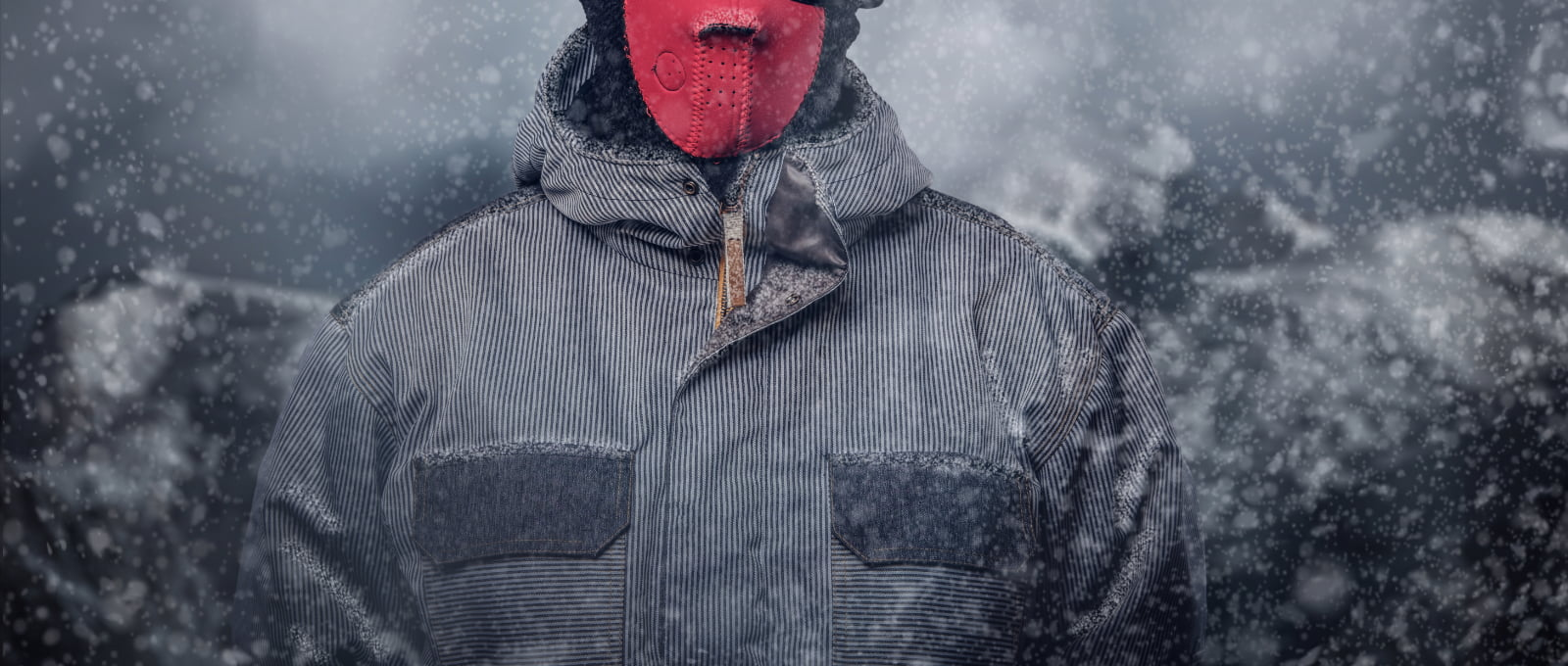 Portrait of a snowboarder dressed in a full protective gear