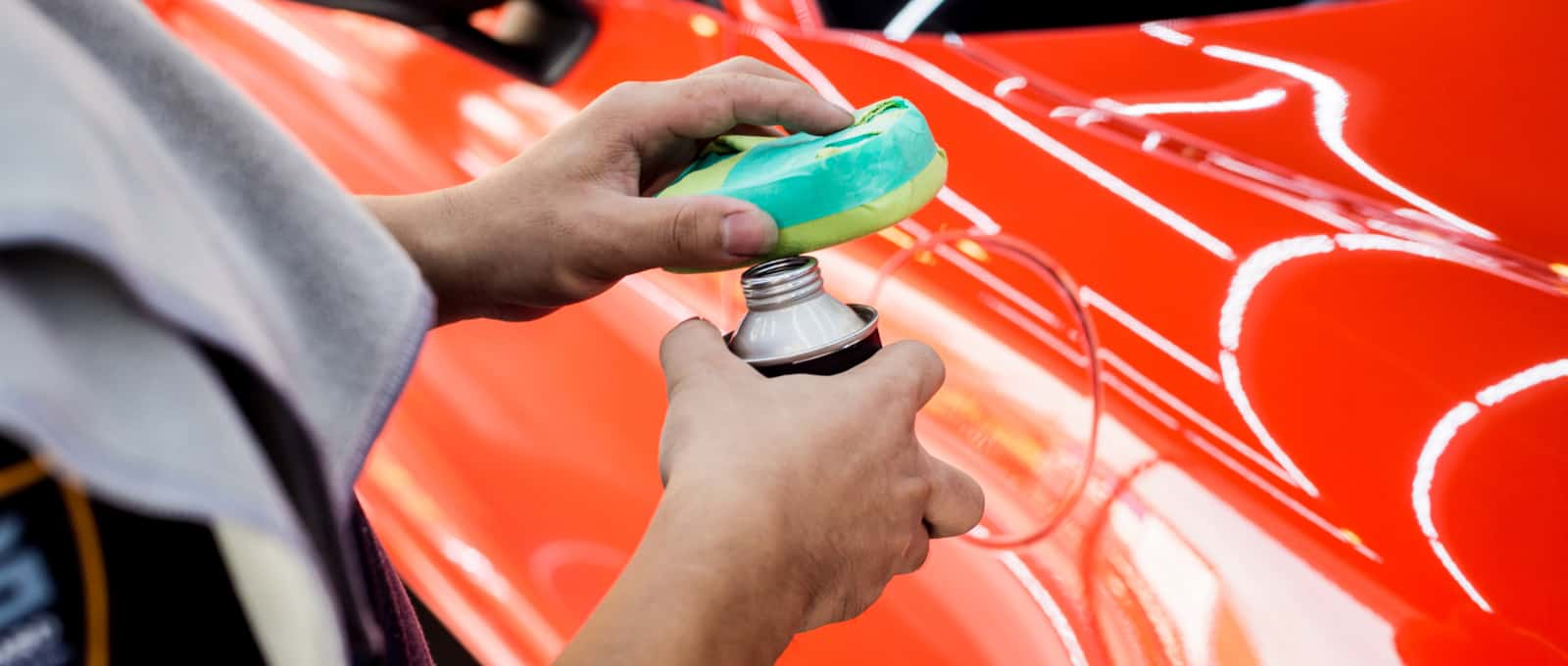 car service worker applying coating on a car